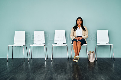 Buy stock photo Studio shot of a mature businesswoman waiting in line against a blue background