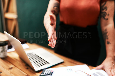 Buy stock photo Cropped shot of an unrecognizable businesswoman standing alone and holding out her hand for a handshake