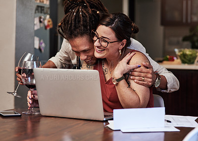Buy stock photo Cropped shot of a cheerful young couple having a video call while enjoying a glass of wine together at home