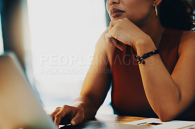 Buy stock photo Cropped shot of an unrecognizable businesswoman using a laptop in her office