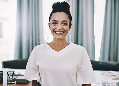 Buy stock photo Portrait of a confident young businesswoman working in her home office