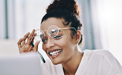 Buy stock photo Shot of a young businesswoman using a laptop while working in her home office