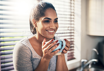 Buy stock photo Cropped shot of a beautiful young woman,enjoying a cup of coffee at home
