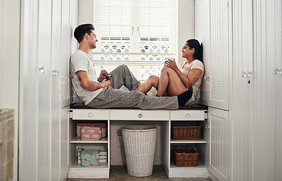 Buy stock photo Shot of a happy young couple sitting together at home