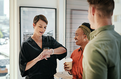 Buy stock photo Cropped shot of an attractive young businesswoman standing with her colleagues in the office and looking at her watch
