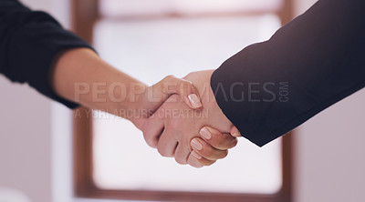 Buy stock photo Cropped shot of an unrecognizable female financial advisor shaking hands with a client in her office during the day