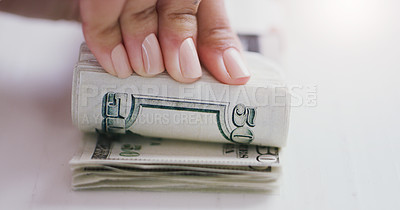 Buy stock photo Cropped shot of an unrecognizable businesswoman counting a stack of money in her office during the day