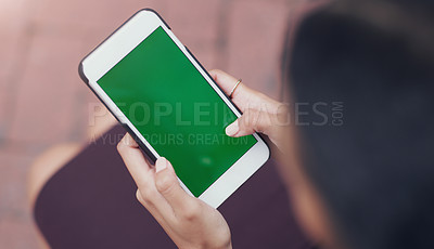 Buy stock photo Cropped shot of an unrecognizable businesswoman using a smartphone while sitting outdoors in the city