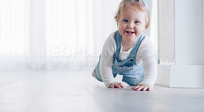 Buy stock photo Full length shot of an adorable little baby girl crawling on the floor at home