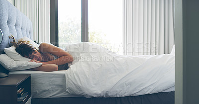 Buy stock photo Cropped shot of an attractive young woman sleeping peacefully in her bedroom at home