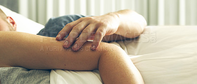 Buy stock photo Cropped shot of an unrecognizable couple sleeping together in their bed at home
