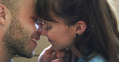 Buy stock photo Closeup shot of an affectionate young couple kissing in their new home on moving day
