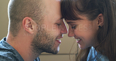 Buy stock photo Closeup shot of an affectionate young couple sharing an intimate moment together in their new home on moving day