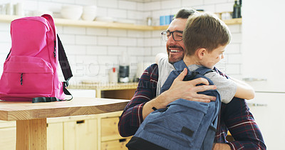 Buy stock photo Shot of a father hugging his son before leaving for school