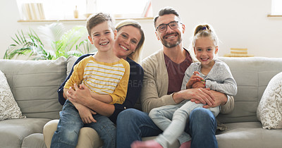 Buy stock photo Portrait of a happy family sitting on the couch together at home