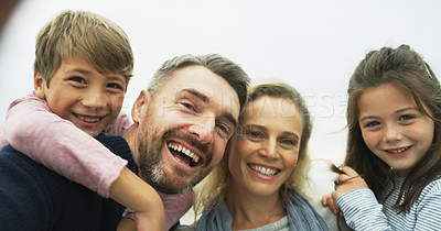 Buy stock photo Portrait of a happy family taking selfies together outdoors