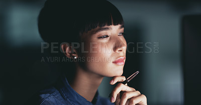 Buy stock photo Shot of a young businesswoman looking thoughtful while working in an office at night