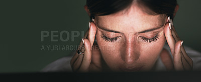 Buy stock photo Closeup shot of a young businesswoman looking stressed out while working in an office at night