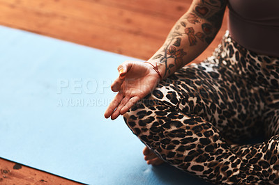 Buy stock photo Closeup shot of a woman meditating on a yoga mat at home