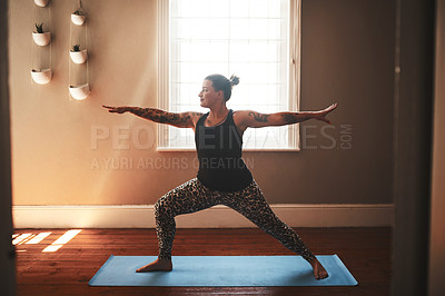 Buy stock photo Shot of a young woman practising yoga at home