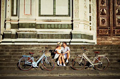 Buy stock photo Shot of an affectionate young couple spending a romantic day with their bicycles in the city of Florence
