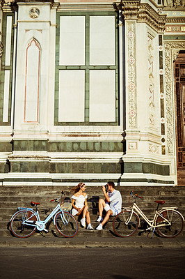 Buy stock photo Shot of a young man taking photos of his girlfriend while touring the city of Florence