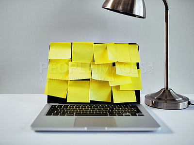 Buy stock photo Still life shot of laptop with sticky notes covering its screen in an office