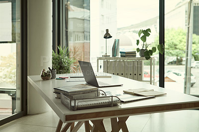 Buy stock photo Still life shot of a laptop, paperwork and books on a desk in an office
