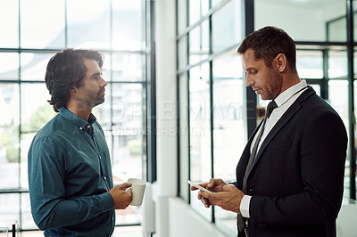 Buy stock photo Shot of two businessmen standing together in an office