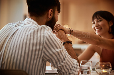 Buy stock photo Cropped shot of a handsome young man kissing his date's hand