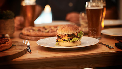Buy stock photo Cropped shot of a burger on a restaurant table