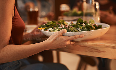 Buy stock photo Cropped shot of an unrecognizable woman holding a bowl of salad