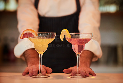 Buy stock photo Cropped shot of an unrecognizable bartender preparing drinks