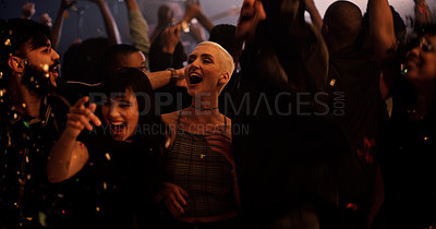 Buy stock photo Cropped shot of a diverse group of young friends dancing at a party in a nightclub