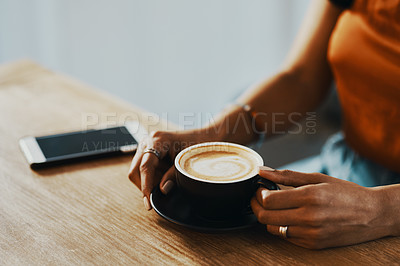 Buy stock photo Cropped shot of a woman having coffee at home