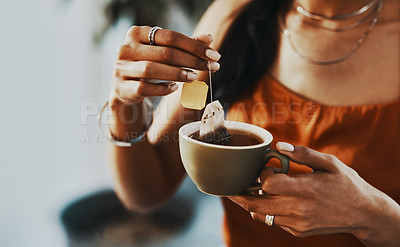 Buy stock photo Cropped shot of a woman having a tea break at home