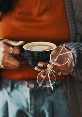 Buy stock photo Cropped shot of a woman having a coffee break at home