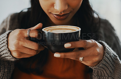 Buy stock photo Cropped shot of a young woman having a coffee break at home