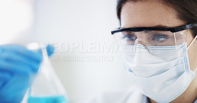 Buy stock photo Shot of a scientist working with samples in a lab