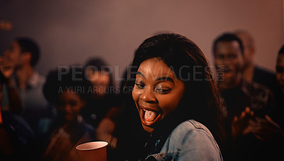 Buy stock photo Cropped shot of an attractive young woman dancing while partying with her friends in a nightclub