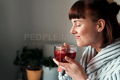 Buy stock photo Cropped shot of an attractive young woman drinking green tea in her bedroom at home