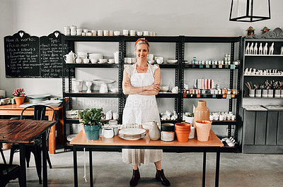 Buy stock photo Full length portrait of an attractive mature woman standing with her arms folded in her pottery workshop