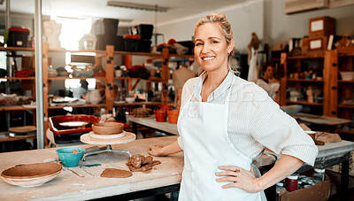 Buy stock photo Portrait of a female artisan standing in her pottery workshop