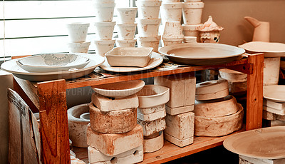 Buy stock photo Cropped shot of handmade earthenware in a pottery workshop