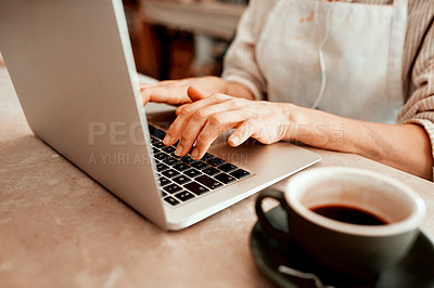 Buy stock photo Cropped shot of a artisan using a laptop in her workshop