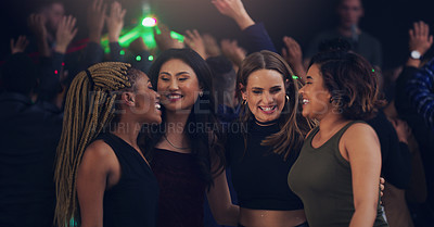 Buy stock photo Cropped shot of a group of girlfriends dancing together in a nightclub