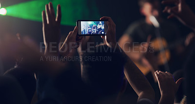 Buy stock photo Cropped shot of an unrecognizable young clubber taking photos while dancing in a nightclub
