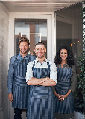 Buy stock photo Portrait of a group of coffee shop employees standing outside their cafe