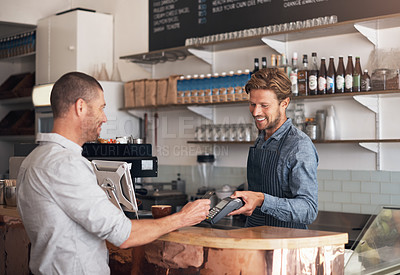 Buy stock photo Shot of a waiter processing a credit card payment from a customer in a cafe