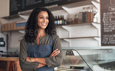 Buy stock photo Shot of a young woman working in a cafe